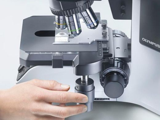 Olympus BX46 microscope's ultra-low slide stage that enables you to keep your arms and hands resting comfortably on the desk surface.